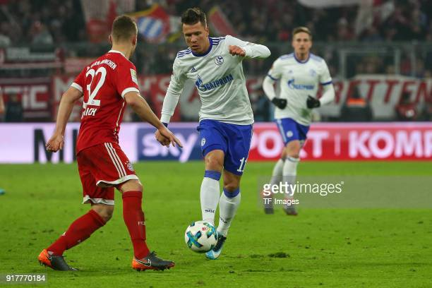 Joshua Kimmich of Bayern Muenchen and Yevhen Konoplyanka of Schalke battle for the ball during the Bundesliga match between FC Bayern Muenchen and FC...