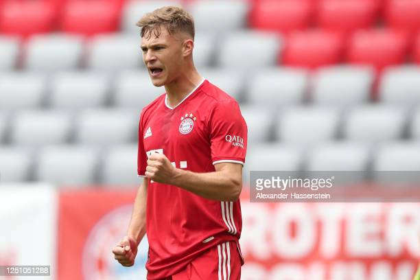 Joshua Kimmich of Bayern Muenchen celebrates after he scores the opening goal during the Bundesliga match between FC Bayern Muenchen and SportClub...