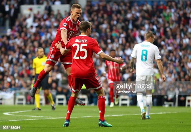 Joshua Kimmich of Bayern Muenchen celebrates after scoring his sides first goal with Thomas Mueller of Bayern Muenchen during the UEFA Champions...