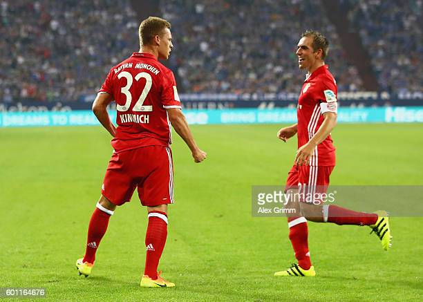 Joshua Kimmich of Bayern Muenchen celebrates with Philipp Lahm of Bayern Muenchen after scoring his sides second goal during the Bundesliga match...