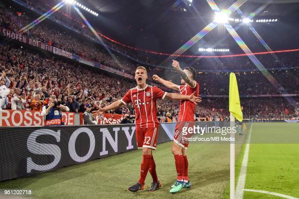 Joshua Kimmich of Bayern Muenchen celebrates with teammate James Rodriguez after scoring the opening goal during the UEFA Champions League Semi Final...