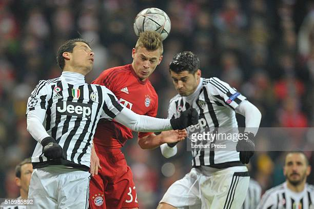 Joshua Kimmich of Bayern Muenchen challenges Hernanes and Alvaro Morata of Juventus Turin during the UEFA Champions League Round of 16 second leg...