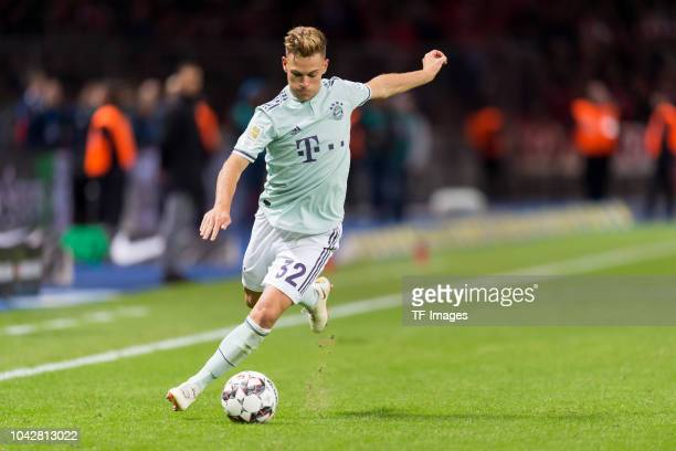 Joshua Kimmich of Bayern Muenchen controls the ball during the Bundesliga match between Hertha BSC and FC Bayern Muenchen at Olympiastadion on...