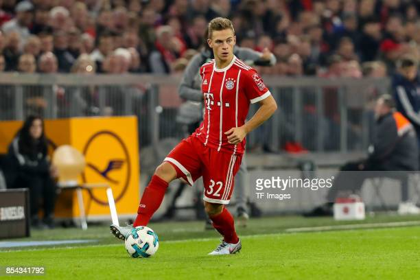 Joshua Kimmich of Bayern Muenchen controls the ball during the Bundesliga match between FC Bayern Muenchen and VfL Wolfsburg at Allianz Arena on...