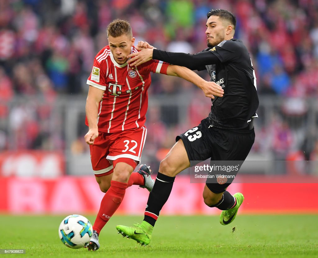 Joshua Kimmich of Bayern Muenchen (l) fights for the ball with Suat Serdar of Mainz during the Bundesliga match between FC Bayern Muenchen and 1. FSV Mainz 05 at Allianz Arena on September 16, 2017 in Munich, Germany.