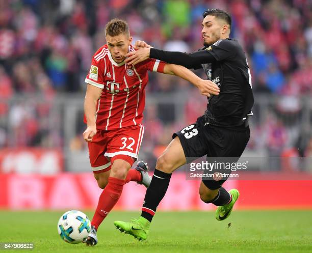 Joshua Kimmich of Bayern Muenchen fights for the ball with Suat Serdar of Mainz during the Bundesliga match between FC Bayern Muenchen and 1 FSV...