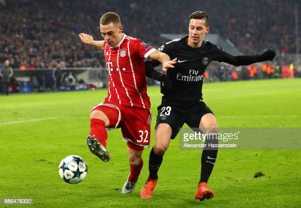Joshua Kimmich of Bayern Muenchen is challenged by Julian Draxler of PSG during the UEFA Champions League group B match between Bayern Muenchen and...