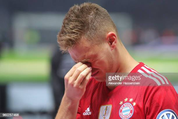 Joshua Kimmich of Bayern Muenchen is dejected after losing the DFB Cup final against Eintracht Frankfurt at Olympiastadion on May 19 2018 in Berlin...