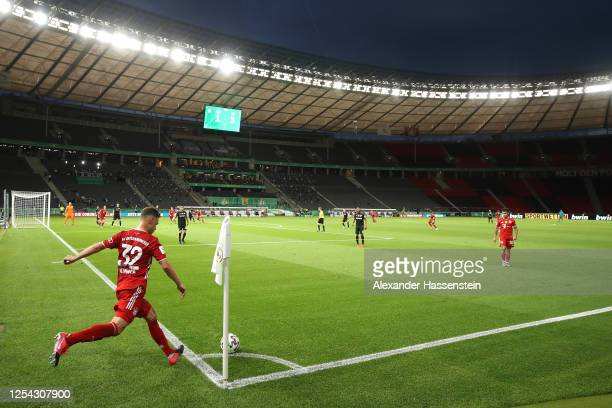 Joshua Kimmich of Bayern Muenchen kicks a corner during the DFB Cup final match between Bayer 04 Leverkusen and FC Bayern Muenchen at Olympiastadion...