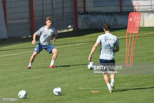 Joshua Kimmich of Bayern Muenchen plays the ball during a training session at Saebener Strasse training ground on April 06 2020 in Munich Germany