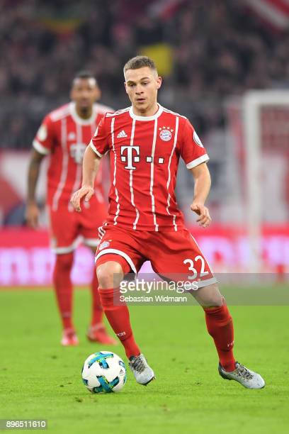 Joshua Kimmich of Bayern Muenchen plays the ball during the DFB Cup match between Bayern Muenchen and Borussia Dortmund at Allianz Arena on December...