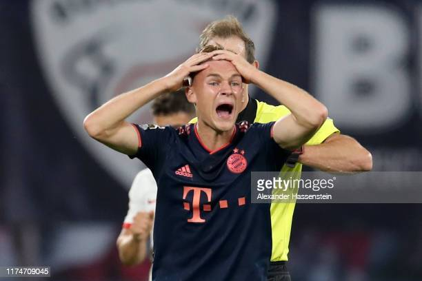 Joshua Kimmich of Bayern Muenchen reacts during the Bundesliga match between RB Leipzig and FC Bayern Muenchen at Red Bull Arena on September 14 2019...