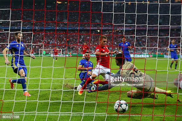 Joshua Kimmich of Bayern Muenchen scores his sides third goal past Soslan Dzhanayev of FC Rostov during the UEFA Champions League Group D match...