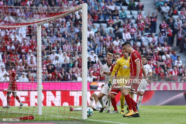Joshua Kimmich of Bayern Muenchen scores his teams fifth goal to make it 50 during the Bundesliga match between FC Bayern Muenchen and SportClub...
