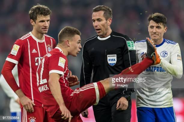 Joshua Kimmich of Bayern Muenchen speak with Tobias Stieler during the Bundesliga match between FC Bayern Muenchen and FC Schalke 04 at Allianz Arena...