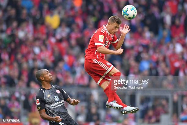 Joshua Kimmich of Bayern Muenchen while Abdou Diallo of Mainz watched during the Bundesliga match between FC Bayern Muenchen and 1 FSV Mainz 05 at...