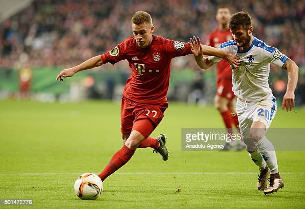 Joshua Kimmich of Bayern Munich and Marcel Heller of Darmstadt vie for the ball during the round of sixteen German Cup match between FC Bayern Munich...