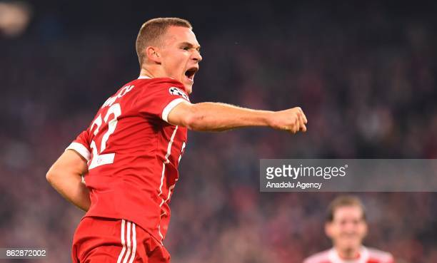 Joshua Kimmich of Bayern Munich celebrates after scoring a goal during the Champions League group B soccer match between FC Bayern Munich and Celtic...