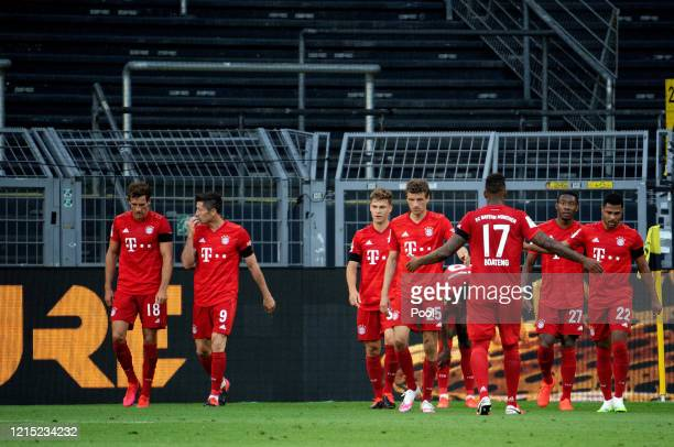 Joshua Kimmich of Bayern Munich celebrates with his team mates after scoring his team's first goal during the Bundesliga match between Borussia...
