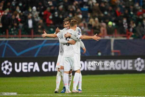 Joshua Kimmich of Bayern Munich celebrates with teammate Javi Martinez after scoring his team's second goal during the UEFA Champions League Group A...
