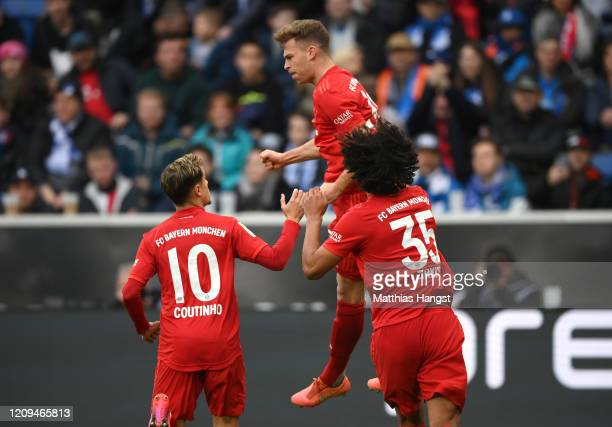 Joshua Kimmich of Bayern Munich celebrates with teammates Philippe Coutinho and Joshua Zirkzee after scoring his sides second goal during the...