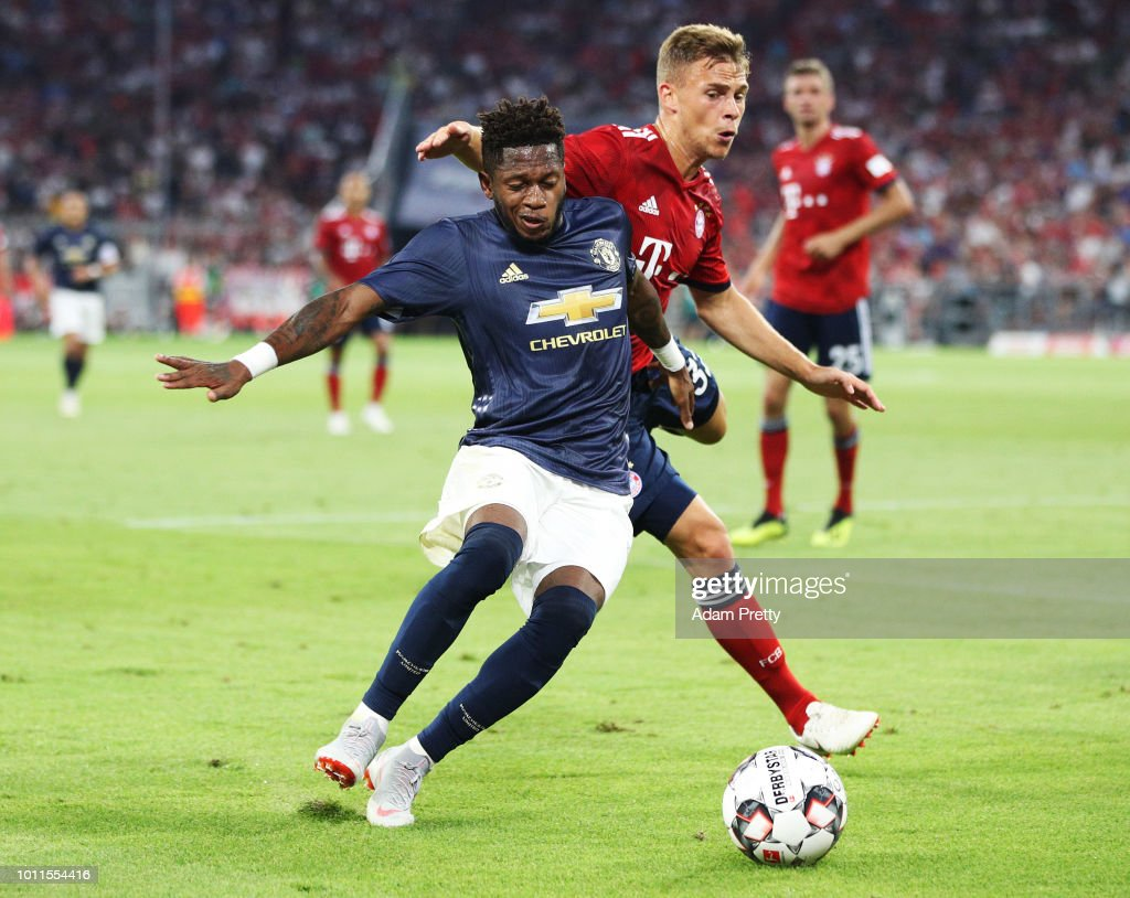 Joshua Kimmich of Bayern Munich challenges Fred of Manchester United during the Bayern Muenchen v Manchester United Friendly Match at Allianz Arena on August 5, 2018 in Munich, Germany.