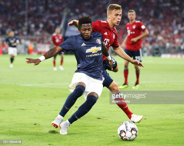 Joshua Kimmich of Bayern Munich challenges Fred of Manchester United during the Bayern Muenchen v Manchester United Friendly Match at Allianz Arena...