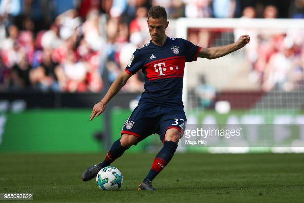 Joshua Kimmich of Bayern Munich controls the ball during the Bundesliga match between 1 FC Koeln and FC Bayern Muenchen at RheinEnergieStadion on May...