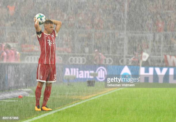 Joshua Kimmich of Bayern Munich in the rain during the Bundesliga match between FC Bayern Muenchen and Bayer 04 Leverkusen at Allianz Arena on August...