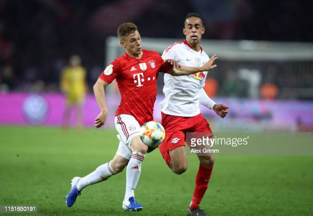Joshua Kimmich of Bayern Munich is challenged by Yussuf Poulsen of RB Leipzig during the DFB Cup final between RB Leipzig and Bayern Muenchen at...