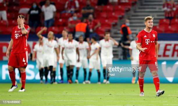 Joshua Kimmich of Bayern Munich reacts after FC Sevilla's first goal during the UEFA Super Cup match between FC Bayern Munich and FC Sevilla at...