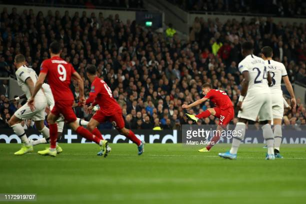 Joshua Kimmich of Bayern Munich scores the equalising goal during the UEFA Champions League group B match between Tottenham Hotspur and Bayern...