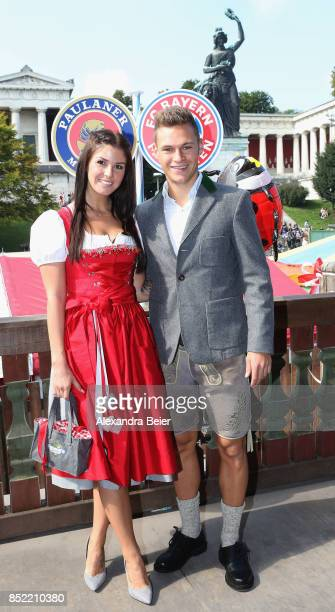 Joshua Kimmich of FC Bayern Muenchen and his girlfriend Lina Meyer attend the Oktoberfest beer festival at Kaefer Wiesenschaenke tent at...