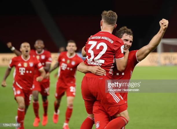 Joshua Kimmich of FC Bayern Muenchen and Leon Goretzka of FC Bayern Muenchen celebrate during the DFB Cup final match between Bayer 04 Leverkusen and...