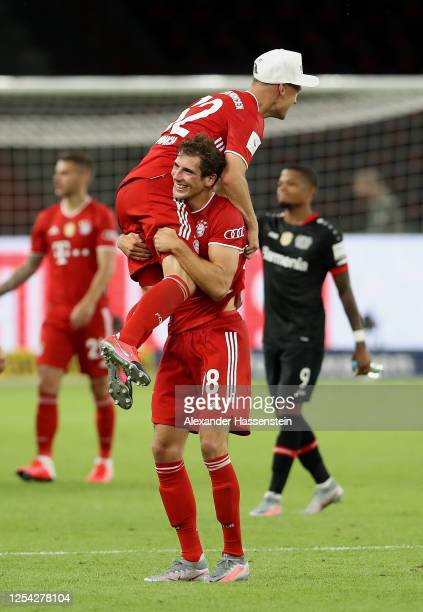 Joshua Kimmich of FC Bayern Muenchen and Leon Goretzka of FC Bayern Muenchen celebrate winning the DFB Cup final match between Bayer 04 Leverkusen...
