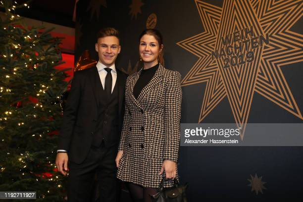 Joshua Kimmich of FC Bayern Muenchen attends with Lina Meyer the clubs Christmas party at Allianz Arena on December 08 2019 in Munich Germany