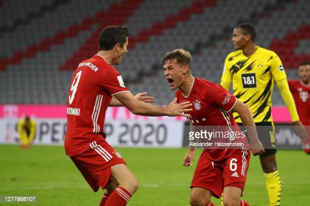 Joshua Kimmich of FC Bayern Muenchen celebrates scoring the winning goal with his team mate Robert Lewandowski during the Supercup 2020 match between...