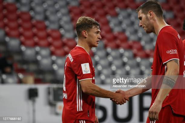Joshua Kimmich of FC Bayern Muenchen celebrates scoring the winning goal with his team mate Niklas Süle during the Supercup 2020 match between FC...