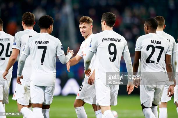 Joshua Kimmich of FC Bayern Muenchen celebrates with his teammates after scoring his team's second goal during the UEFA Champions League Group A...