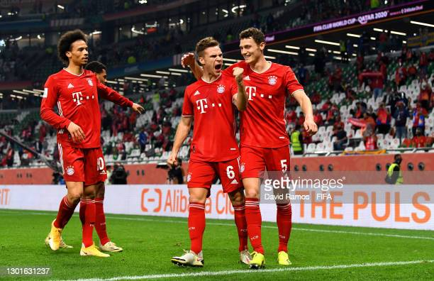 Joshua Kimmich of FC Bayern Muenchen celebrates with teammates Benjamin Pavard and Leroy Sane after scoring their team's first goal which was later...