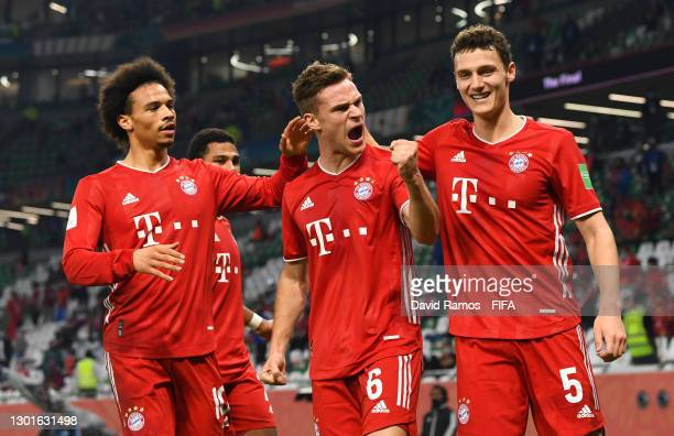 Joshua Kimmich of FC Bayern Muenchen celebrates with teammates Leroy Sane and Benjamin Pavard after scoring their team's first goal which was later...