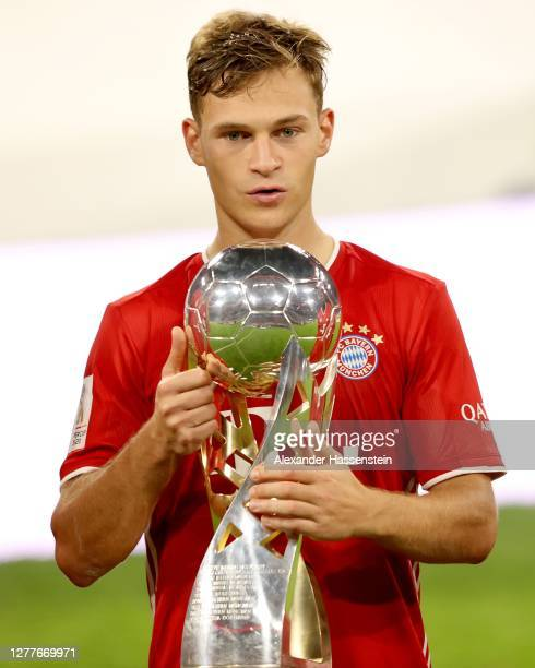 Joshua Kimmich of FC Bayern Muenchen celebrates with the Supercup trophy after the Supercup 2020 match between FC Bayern München and Borussia...