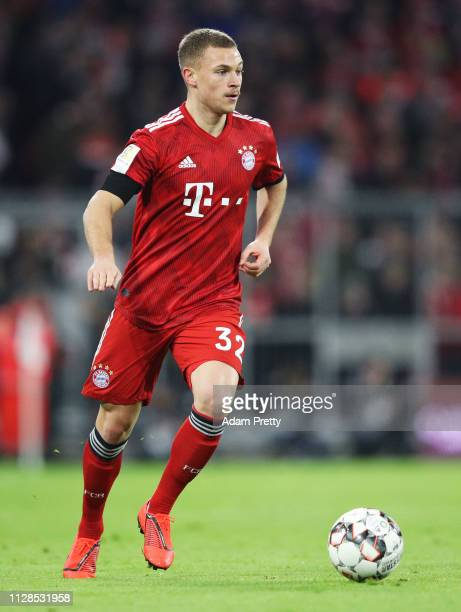 Joshua Kimmich of FC Bayern Muenchen controls the ball during the Bundesliga match between FC Bayern Muenchen and FC Schalke 04 at Allianz Arena on...