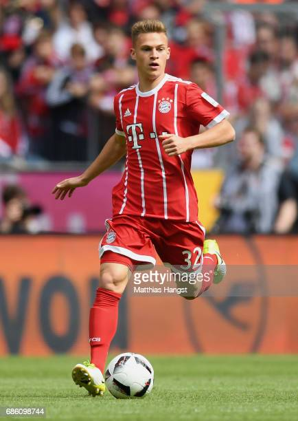 Joshua Kimmich of FC Bayern Muenchen controls the ball during the Bundesliga match between Bayern Muenchen and SC Freiburg at Allianz Arena on May 20...