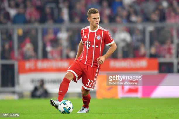 Joshua Kimmich of FC Bayern Muenchen controls the ball during the Bundesliga match between FC Bayern Muenchen and VfL Wolfsburg at Allianz Arena on...