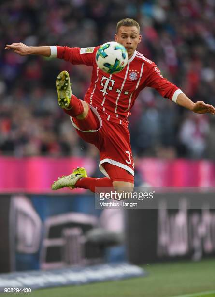 Joshua Kimmich of FC Bayern Muenchen controls the ball during the Bundesliga match between FC Bayern Muenchen and SV Werder Bremen at Allianz Arena...