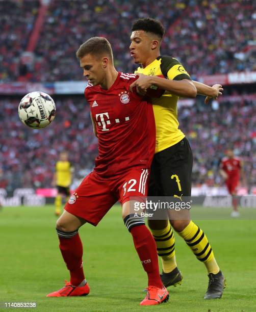 Joshua Kimmich of FC Bayern Muenchen fights for the ball with Jadon Sancho of Borussia Dortmund during the Bundesliga match between FC Bayern...