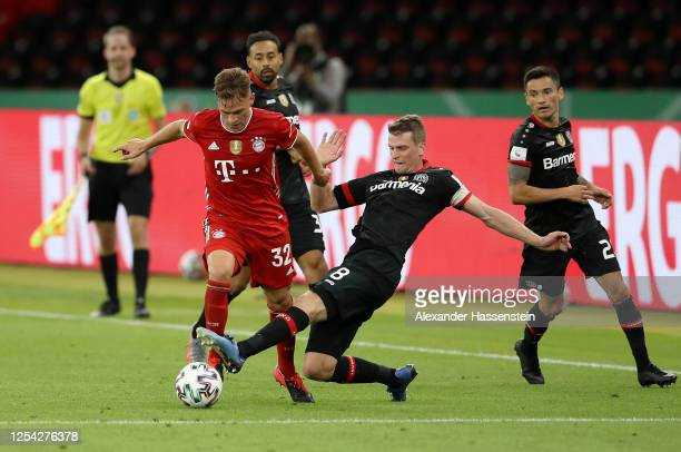 Joshua Kimmich of FC Bayern Muenchen is challenged by Lars Bender of Bayer Leverkusen during the DFB Cup final match between Bayer 04 Leverkusen and...