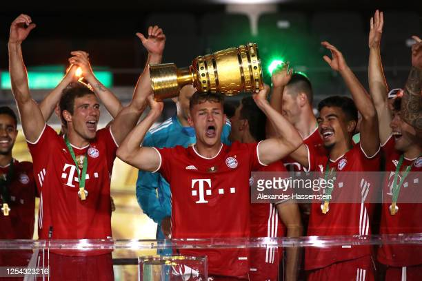 Joshua Kimmich of FC Bayern Muenchen lifts the DFB Cup winners trophy in celebration after the DFB Cup final match between Bayer 04 Leverkusen and FC...