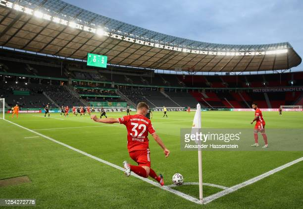 Joshua Kimmich of FC Bayern Muenchen performs a corner kick during the DFB Cup final match between Bayer 04 Leverkusen and FC Bayern Muenchen at...
